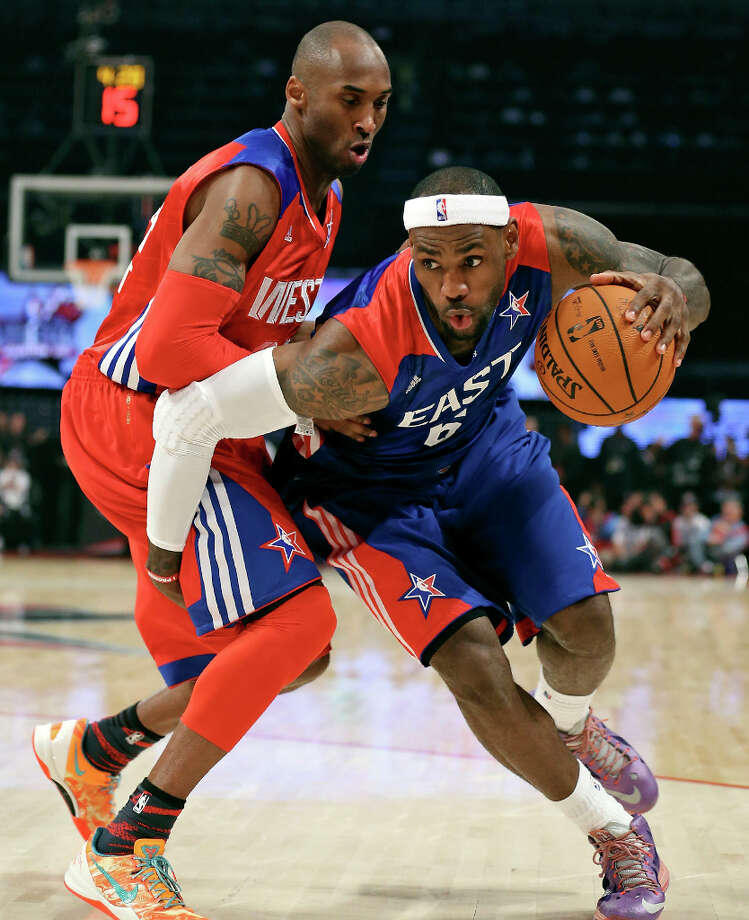 West's Kobe Bryant defends East's LeBron James during second half action of the 62nd All-Star game at the Toyota Center Sunday Feb. 17, 2013 in Houston. The West won 143-138. Photo: Edward A. Ornelas, San Antonio Express-News / © 2013 San Antonio Express-News