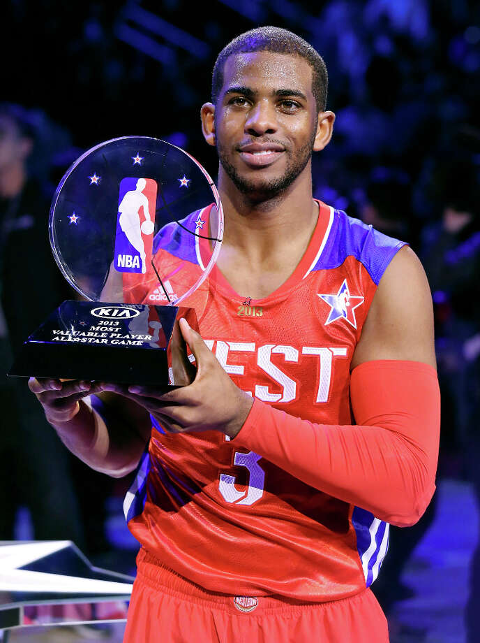 West's Chris Paul holds the game MVP Trophy after the 62nd All-Star game with the East at the Toyota Center Sunday Feb. 17, 2013 in Houston. The West won 143-138. Photo: Edward A. Ornelas, San Antonio Express-News / © 2013 San Antonio Express-News
