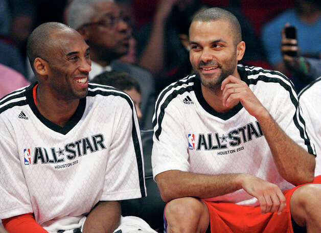 West's Kobe Bryant and Tony Parker joke while on the bench during first half action of the 62nd All-Star game against the East at the Toyota Center Sunday Feb. 17, 2013 in Houston. Photo: Edward A. Ornelas, San Antonio Express-News / © 2013 San Antonio Express-News