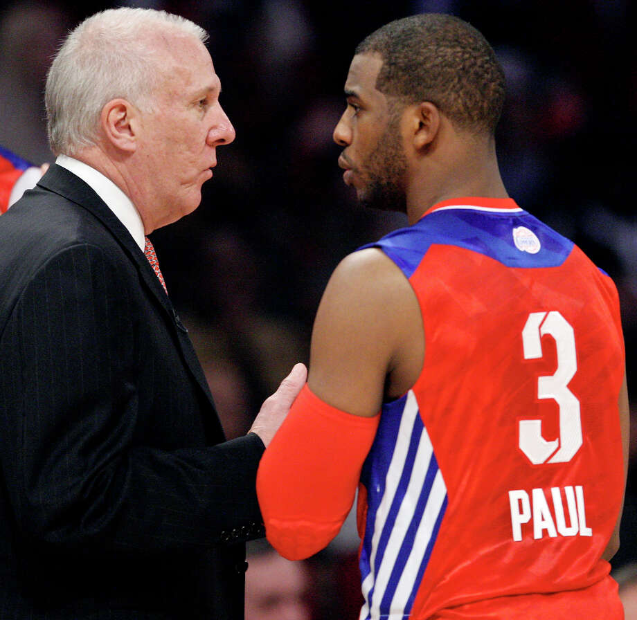 West head coach Gregg Popvich talks with West's Chris Paul  during first half action of the 62nd All-Star game against the East at the Toyota Center Sunday Feb. 17, 2013 in Houston. Photo: Edward A. Ornelas, San Antonio Express-News / © 2013 San Antonio Express-News