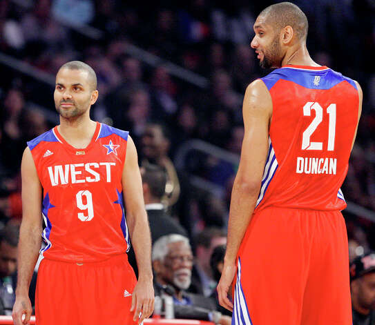 West's Tony Parker and Tim Duncan pause during a timeout in first half action of the 62nd All-Star game against the East at the Toyota Center Sunday Feb. 17, 2013 in Houston. Photo: Edward A. Ornelas, San Antonio Express-News / © 2013 San Antonio Express-News