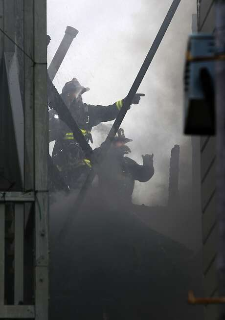 Crews battle last year's multibuilding blaze on Capp Street that resulted in a family's move to Parkmerced. Photo: Paul Chinn, The Chronicle