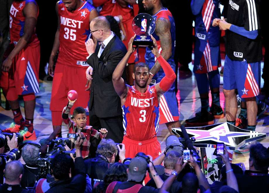Chris Paul stands alone among his All-Star peers as the MVP recipient at Toyota Center on Sunday night. He scored 20 points and added 15 assists and four steals. Photo: Billy Smith II, Staff / © 2013  Houston Chronicle
