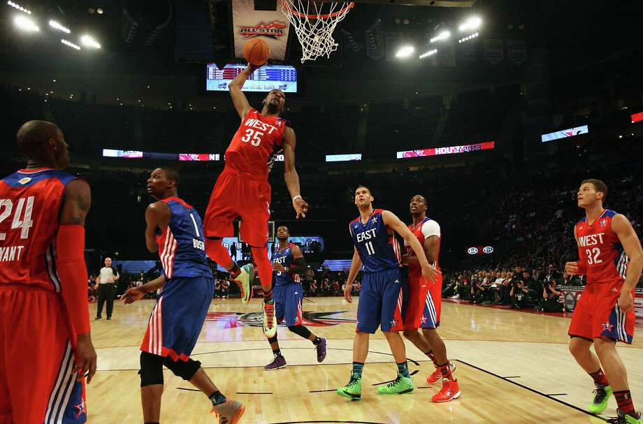The Thunder's Kevin Durant was just one of the many All-Stars who played well above the rim on Sunday night at Toyota Center. Durant had a game-high 30 points and six rebounds but lost out on MVP honors to the Clippers' Chris Paul. Photo: James Nielsen, Staff / © 2013  Houston Chronicle