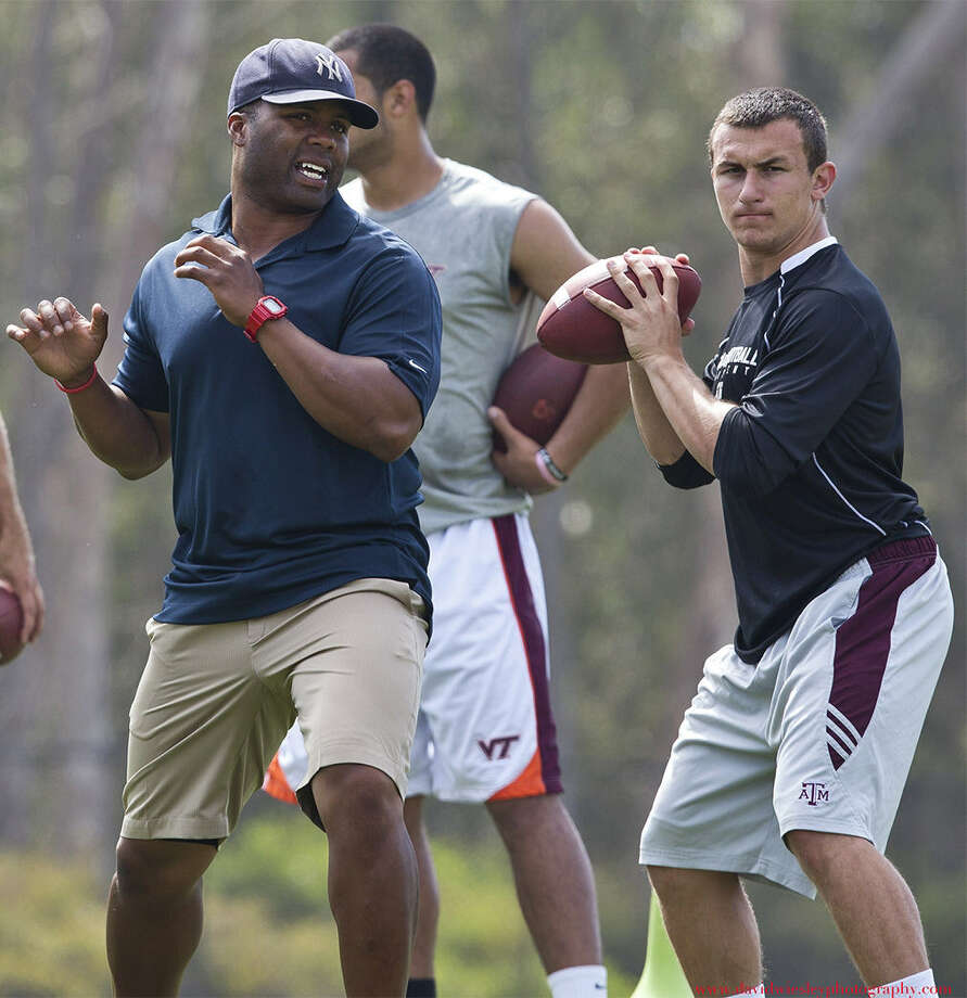 George Whitfield Jr. (left), who has worked with some of the top QBs around, trained Texas A&M's Johnny Manziel last summer. Photo: Courtesy Photo / Whitfield QB Academy