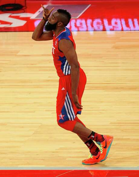 The Rockets' James Harden celebrates after hitting a 3-pointer in the second half. He finished with 15 points on 6-of-13 shooting, including 3-of-8 on 3-pointers. Photo: Billy Smith II, Staff / © 2013  Houston Chronicle