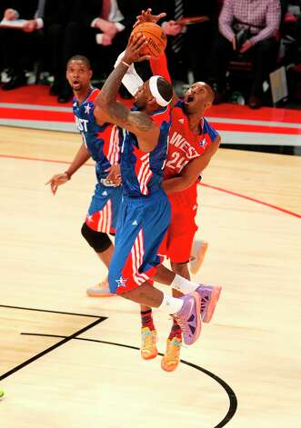 LeBron James of the Miami Heat (6) has his shot blocked by Kobe Bryant of the Los Angeles Lakers (24) during the second half. Photo: Billy Smith II / © 2013  Houston Chronicle
