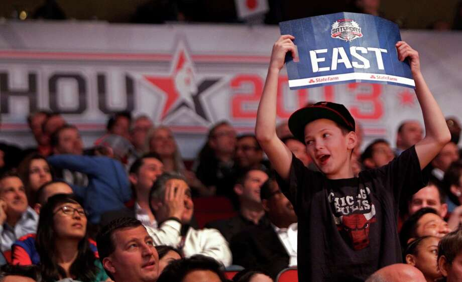 Nathan Cupps, 11, of Plainfield, IL cheers on the East Team during the second half of the NBA All-Star Game at the Toyota Center on Sunday, Feb. 17, 2013, in Houston. ( Melissa Phillip / Houston Chronicle ) Photo: Melissa Phillip, Staff / © 2013  Houston Chronicle