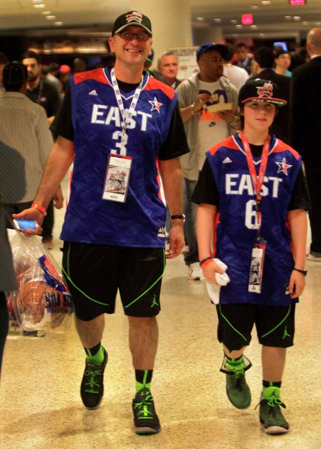 Michael Meisel, left, of Baltimore and his son, Austin Meisel, 12, take a break at half-time of the NBA All-Star Game at the Toyota Center on Sunday, Feb. 17, 2013, in Houston. Photo: Melissa Phillip / © 2013  Houston Chronicle
