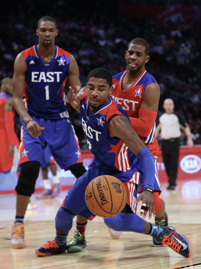 Kyrie Irving #2 of the Cleveland Cavaliers and the Eastern Conference goes for the ball in front of Chris Paul #3 of the Los Angeles Clippers and the Western Conference during the 2013 NBA All-Star game at the Toyota Center on February 17, 2013 in Houston. Photo: Ronald Martinez, Getty Images / 2013 Getty Images