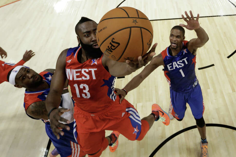 James Harden #13 of the Houston Rockets and the Western Conference goes up for a shot between LeBron James #6 and Chris Bosh #1 of the Eastern Conference during the 2013 NBA All-Star game at the Toyota Center on February 17, 2013 in Houston. Photo: Pool, Getty Images / 2013 Getty Images