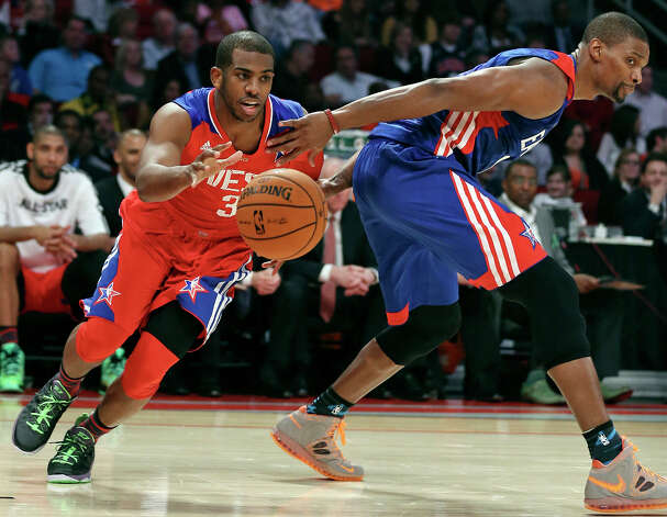 West's Chris Paul looks for room around East's Chris Bosh during first half action of the 62nd All-Star game at the Toyota Center Sunday Feb. 17, 2013 in Houston. Photo: Edward A. Ornelas, San Antonio Express-News / © 2013 San Antonio Express-News