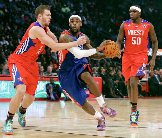 East's LeBron James looks for room between West's David Lee and West's Zach Randolph during second half action of the 62nd All-Star game at the Toyota Center Sunday Feb. 17, 2013 in Houston. Photo: Edward A. Ornelas, San Antonio Express-News / © 2013 San Antonio Express-News