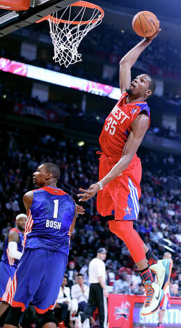 West's Kevin Durant goes up for a dunk over East's Chris Bosh during first half action of the 62nd All-Star game at the Toyota Center Sunday Feb. 17, 2013 in Houston. Photo: Edward A. Ornelas, San Antonio Express-News / © 2013 San Antonio Express-News