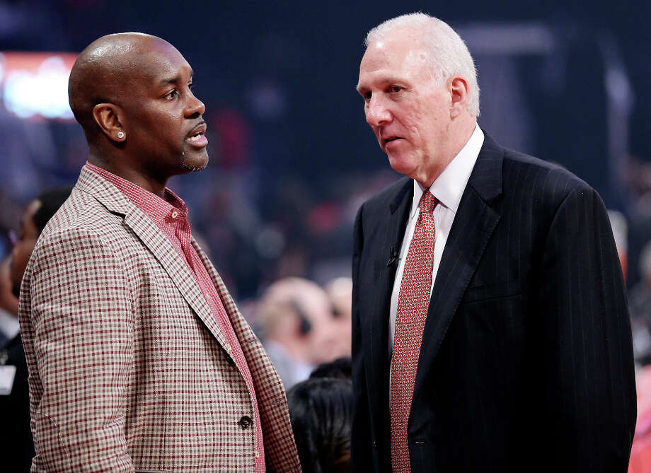 Former NBA player Gary Payton (left) talks with West's head coach Gregg Popvich during halftime of the 62nd All-Star game at the Toyota Center Sunday Feb. 17, 2013 in Houston. Photo: Edward A. Ornelas, San Antonio Express-News / © 2013 San Antonio Express-News