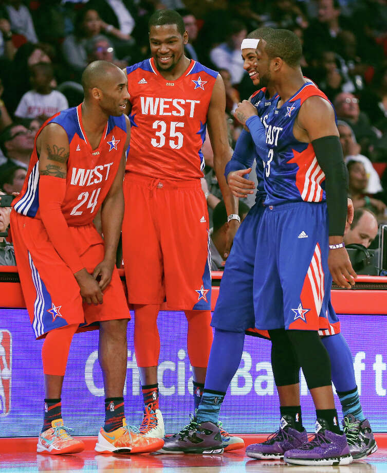 West's Kobe Bryant (from left), Kevin Durant, East's Carmelo Anthony, and Dwyane Wade talk during first half action of the 62nd All-Star game at the Toyota Center Sunday Feb. 17, 2013 in Houston. Photo: Edward A. Ornelas, San Antonio Express-News / © 2013 San Antonio Express-News