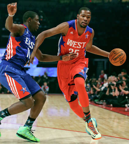 West's Kevin Durant looks for room around East's Jrue Holiday during first half action of the 62nd All-Star game at the Toyota Center Sunday Feb. 17, 2013 in Houston. Photo: Edward A. Ornelas, San Antonio Express-News / © 2013 San Antonio Express-News