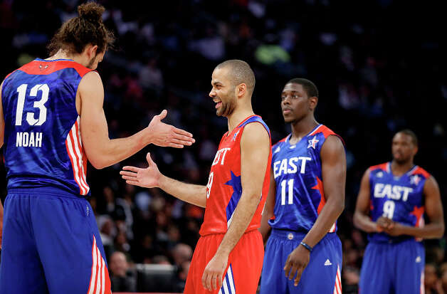 East's Joakim Noah (left) talks with West's Tony Parker during second half action of the 62nd All-Star game at the Toyota Center Sunday Feb. 17, 2013 in Houston. Photo: Edward A. Ornelas, San Antonio Express-News / © 2013 San Antonio Express-News