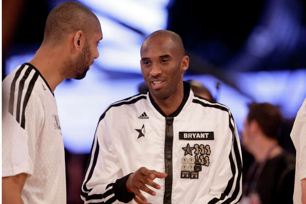 West Team's Tim Duncan of the San Antonio Spurs, left, and Kobe Bryant of the Los Angeles Lakers before the NBA All-Star basketball game Sunday, Feb. 17, 2013, in Houston. Photo: Eric Gay, Associated Press / AP