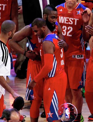 James Harden of the Houston Rockets (13) congratulates Chris Paul of the Los Angeles Clippers (3) on winning the games MVP during the at the end of the NBA All-Start Game at the Toyota Center on Sunday, Feb. 17, 2013, in Houston. Photo: Billy Smith II, Houston Chronicle / © 2013  Houston Chronicle
