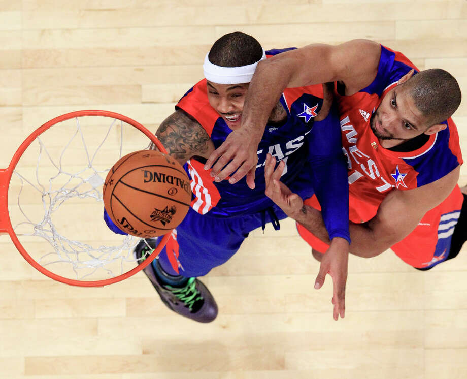 West Team's Tim Duncan of the San Antonio Spurs shoots over East Team's Carmelo Anthony of the New York Knicks, during the first half of the NBA All-Star basketball game Sunday, Feb. 17, 2013, in Houston. Photo: Lucy Nicholson, Associated Press / Reuters Pool