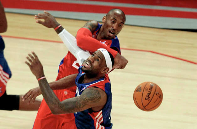 LeBron James of the Miami Heat (6) has his shot blocked by Kobe Bryant of the Los Angeles Lakers (24) during the second half of the NBA All-Start Game at the Toyota Center on Sunday, Feb. 17, 2013, in Houston. Photo: Billy Smith II, Houston Chronicle / © 2013  Houston Chronicle