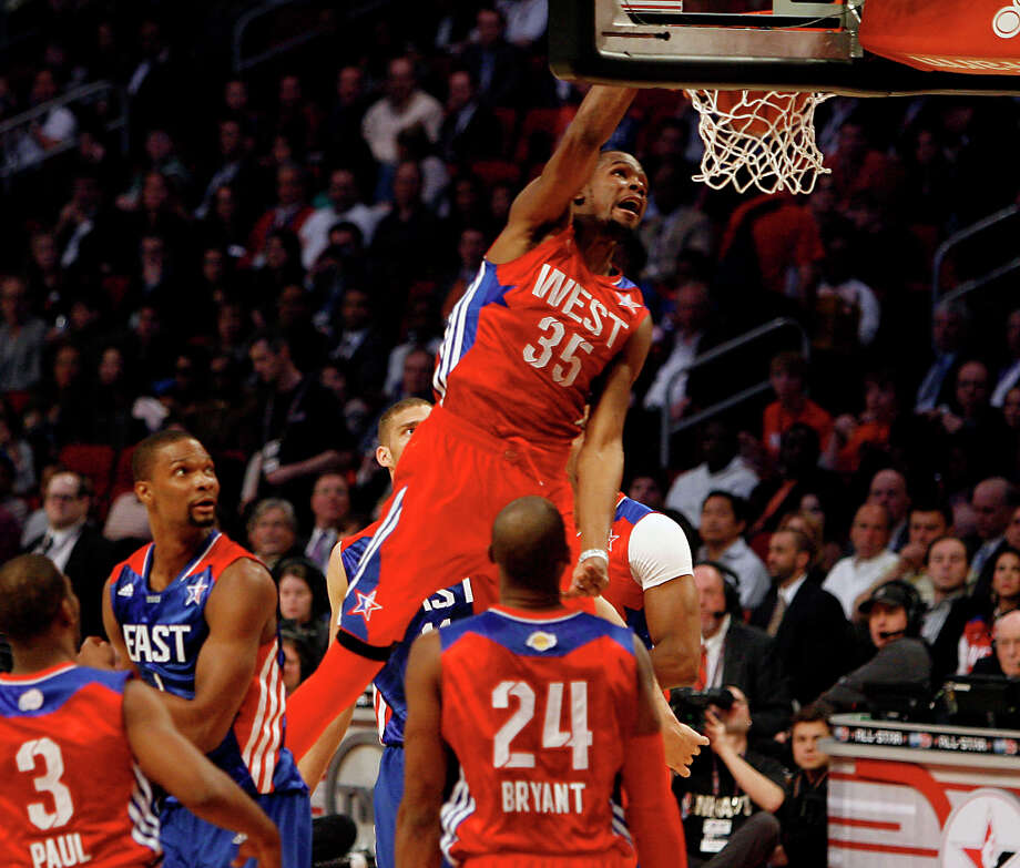 Kevin Durant of the Oklahoma City Thunder (35) goes up for a dunk during the first half of the NBA All-Star Game at the Toyota Center on Sunday, Feb. 17, 2013, in Houston. Photo: James Nielsen, Houston Chronicle / © 2013  Houston Chronicle