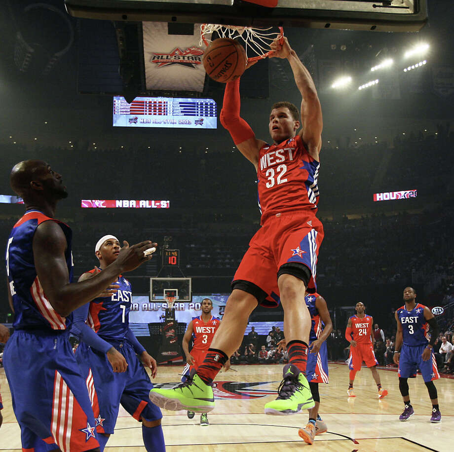 Blake Griffin of the Los Angeles Clippers (32) dunks over Kevin Garnett of the Boston Celtics (5) during the first half of the NBA All-Star Game at the Toyota Center on Sunday, Feb. 17, 2013, in Houston. Photo: James Nielsen, Houston Chronicle / © 2013  Houston Chronicle