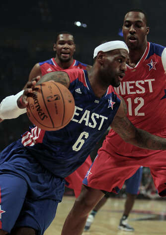 LeBron James of the Miami Heat drives past Dwight Howard of the Los Angeles Lakers during the first half of the NBA All-Star Game at the Toyota Center on Sunday, Feb. 17, 2013, in Houston. Photo: James Nielsen, Houston Chronicle / © 2013  Houston Chronicle