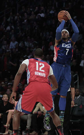 Carmelo Anthony of the New York Knicks (7) shoots over Dwight Howard of the Los Angeles Lakers during the first half of the NBA All-Star Game at the Toyota Center on Sunday, Feb. 17, 2013, in Houston. Photo: James Nielsen, Houston Chronicle / © 2013  Houston Chronicle
