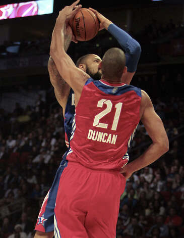 Tim Duncan of the San Antonio Spurs (21) defends against Tyson Chandler of the New York Knicks (6) during the first half of the NBA All-Star Game at the Toyota Center on Sunday, Feb. 17, 2013, in Houston. Photo: James Nielsen, Houston Chronicle / © 2013  Houston Chronicle