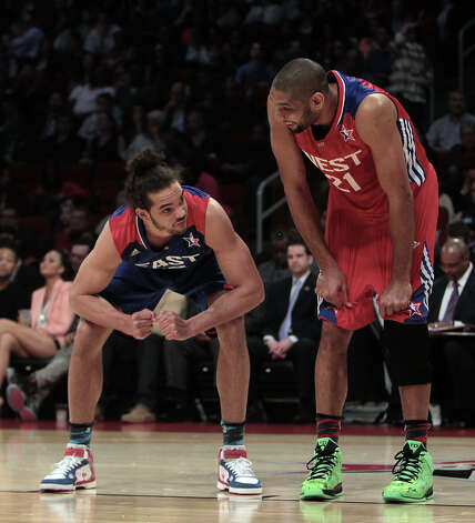 Joakim Noah of the Chicago Bulls (13) and Tim Duncan of the San Antonio Spurs (21) prepare to rebound a foul shot during the first half of the NBA All-Star Game at the Toyota Center on Sunday, Feb. 17, 2013, in Houston. Photo: James Nielsen, Houston Chronicle / © 2013  Houston Chronicle