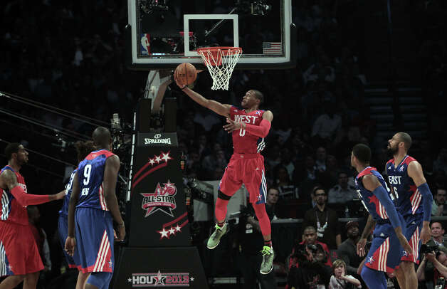 Russell Westbrook of the Oklahoma City Thunder (0) goes up for a layup during the first half of the NBA All-Star Game at the Toyota Center on Sunday, Feb. 17, 2013, in Houston. Photo: James Nielsen, Houston Chronicle / © 2013  Houston Chronicle