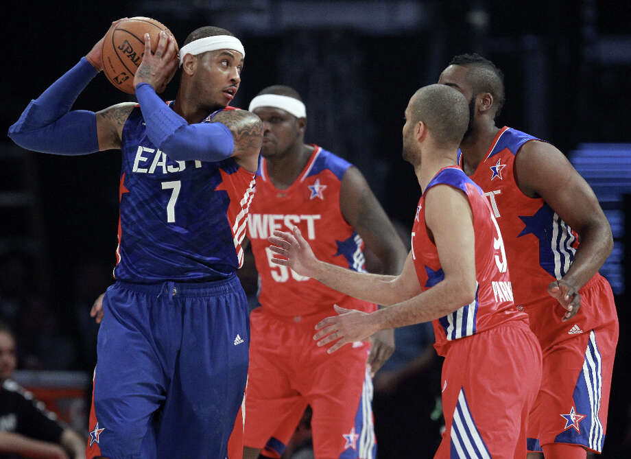 Carmelo Anthony #7 of the New York Knicks and the Eastern Conference is guarded by Zach Randolph #50, James Harden #13 and Tony Parker #9 of the Western Conference in the first quarter during the 2013 NBA All-Star game at the Toyota Center on February 17, 2013 in Houston. Photo: Ronald Martinez, Getty Images / 2013 Getty Images