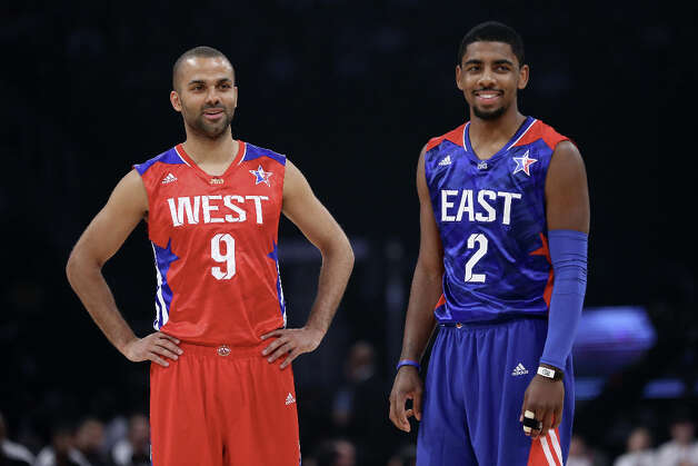 Tony Parker #9 of the San Antonio Spurs and the Western Conference stands with Kyrie Irving #2 of the Cleveland Cavaliers and the Eastern Conference in the second quarter during the 2013 NBA All-Star game at the Toyota Center on February 17, 2013 in Houston. Photo: Ronald Martinez, Getty Images / 2013 Getty Images