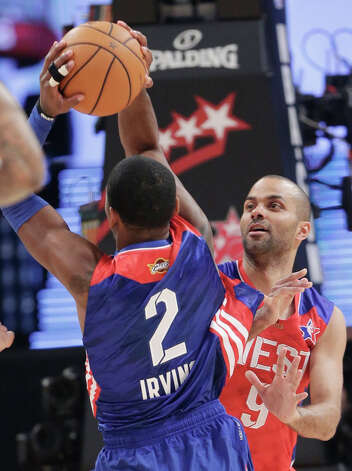 West Team's Tony Parker from France, of the San Antonio Spurs defends East Team's Kyrie Irving of the Cleveland Cavaliers during the first half of the NBA All-Star basketball game Sunday, Feb. 17, 2013, in Houston. Photo: Eric Gay, Associated Press / AP