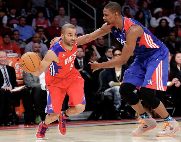 West Team's Tony Parker from France, of the San Antonio Spurs drives against East Team's Chris Bosh of the Miami Heat during the first half of the NBA All-Star basketball game Sunday, Feb. 17, 2013, in Houston. Photo: Eric Gay, Associated Press / AP
