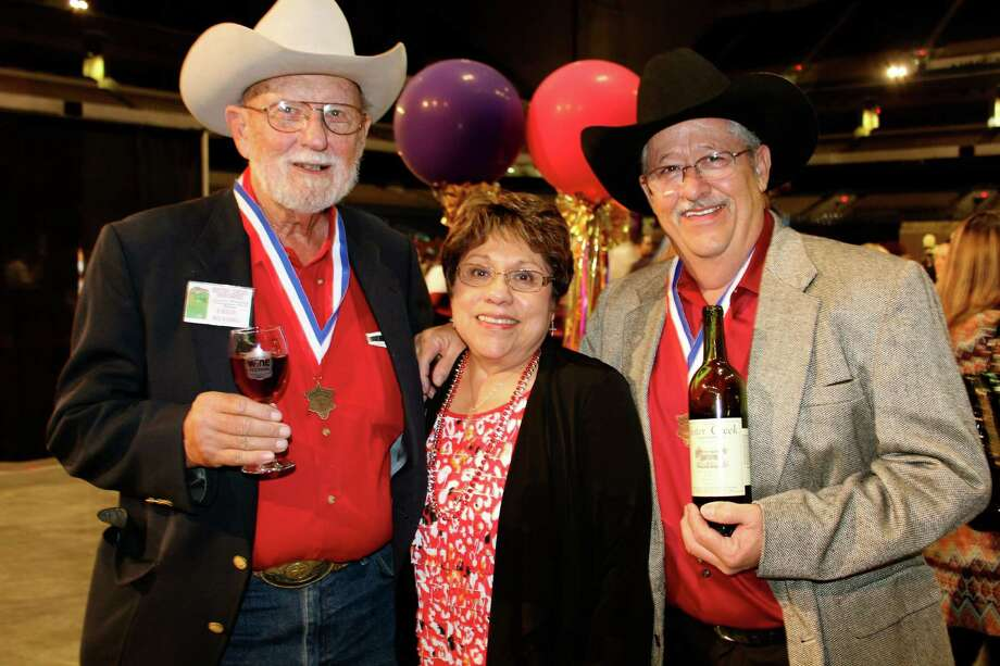 Attendees sample food and drinks at the Fine Wine & Cuisine Tasting event during the San Antonio Wine Festival on Sunday night, Feb. 17, 2013, at the Alamodome. Photo: Yvonne Zamora, MySA.com