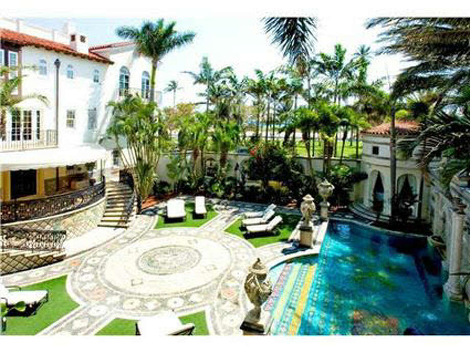 Versace's opulent taste appears in the outdoor spaces