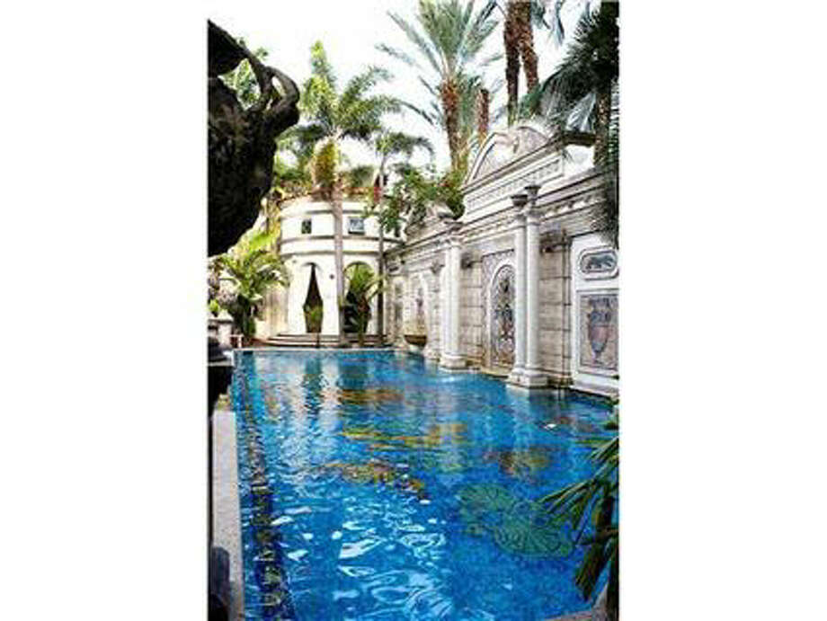 Versace's signature pool lined with gold and frescoes