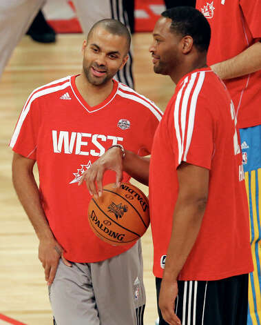 San Antonio Spurs' Tony Parker (left) talks with former San Antonio Spurs' Robert Horry before the State Farm All-Star Saturday Night at the Toyota Center Saturday, Feb. 16, 2013, in Houston. Photo: Edward A. Ornelas, San Antonio Express-News / © 2013 San Antonio Express-News