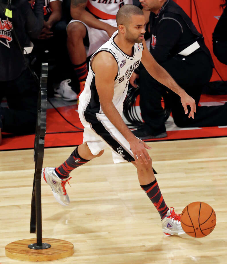 San Antonio Spurs' Tony Parker competes in the Taco Bell Skills Challenge at the Toyota Center Saturday, Feb. 16, 2013, in Houston. Photo: Edward A. Ornelas, San Antonio Express-News / © 2013 San Antonio Express-News