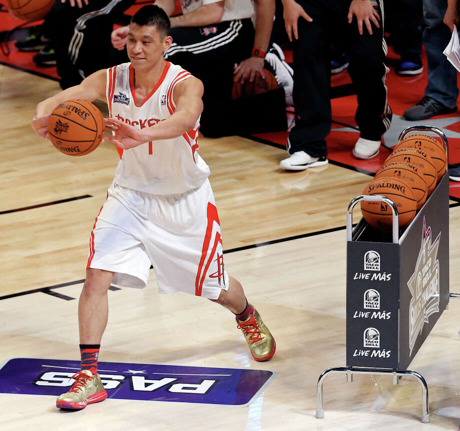 Houston Rockets' Jeremy Lin passes during the Taco Bell Skills Challenge at the Toyota Center Saturday, Feb. 16, 2013, in Houston. Photo: Edward A. Ornelas, San Antonio Express-News / © 2013 San Antonio Express-News