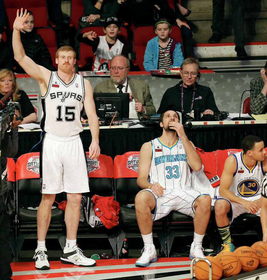 San Antonio Spurs' Matt Bonner (from left) waves after taking part in the Foot Locker Three-Point Contest as New Orleans Hornets' Ryan Anderson and Golden State Warriors' Stephen Curry look on at the Toyota Center Saturday, Feb. 16, 2013, in Houston. Photo: Edward A. Ornelas, San Antonio Express-News / © 2013 San Antonio Express-News