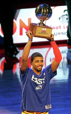 Cleveland Cavaliers' Kyrie Irving holds the trophy after winning the Foot Locker Three-Point Contest at the Toyota Center Saturday, Feb. 16, 2013, in Houston. Photo: Edward A. Ornelas, San Antonio Express-News / © 2013 San Antonio Express-News