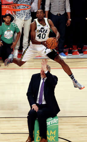 Jeremy Evans of the Utah Jazz dunks the ball over former Jazz player Mark Eaton during the Sprite Slam Dunk Contest at the Toyota Center Saturday, Feb. 16, 2013, in Houston. Photo: Edward A. Ornelas, San Antonio Express-News / © 2013 San Antonio Express-News
