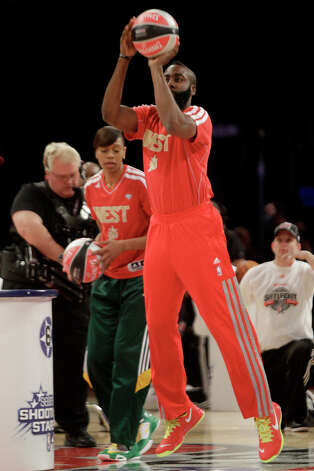 James Harden of the Houston Rockets takes a shot during the NBA All-Star Shooting Stars competition at the Toyota Center on All-Star Saturday Night, Saturday, Feb. 16, 2013, in Houston. Photo: Melissa Phillip, Houston Chronicle / © 2013  Houston Chronicle
