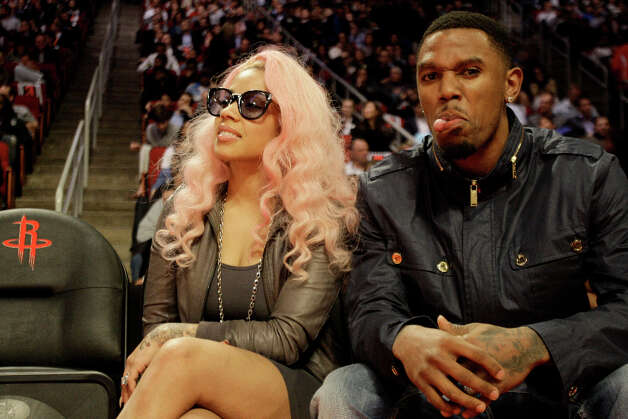 Cleveland Cavaliers guard Daniel Booby Gibson, right, sticks out his tongue as he sits with Keysia Cole as they war the NBA All-Star Shooting Stars competition at the Toyota Center on All-Star Saturday Night, Saturday, Feb. 16, 2013, in Houston. Gibson is from Houston, where he played at Jones High School before the University of Texas. Photo: Melissa Phillip, Houston Chronicle / © 2013  Houston Chronicle