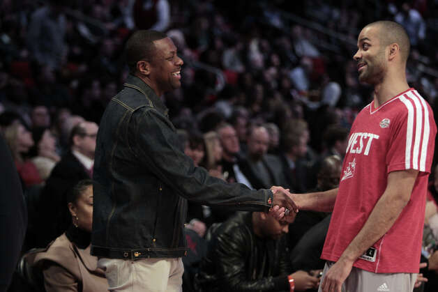 Actor and comedian Chris Tucker shakes hands with Tony Parker of the San Antonio Spurs before the NBA All-Star Skills Challenge at the Toyota Center on All-Star Saturday Night, Saturday, Feb. 16, 2013, in Houston. Photo: James Nielsen, Houston Chronicle / © 2013  Houston Chronicle