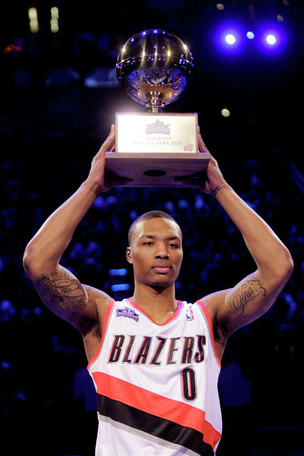 Damian Lillard of the Portland Trailblazers show off the trophy after winning the NBA All-Star Skills Challenge at the Toyota Center on All-Star Saturday Night, Saturday, Feb. 16, 2013, in Houston. Photo: Melissa Phillip, Houston Chronicle / © 2013  Houston Chronicle